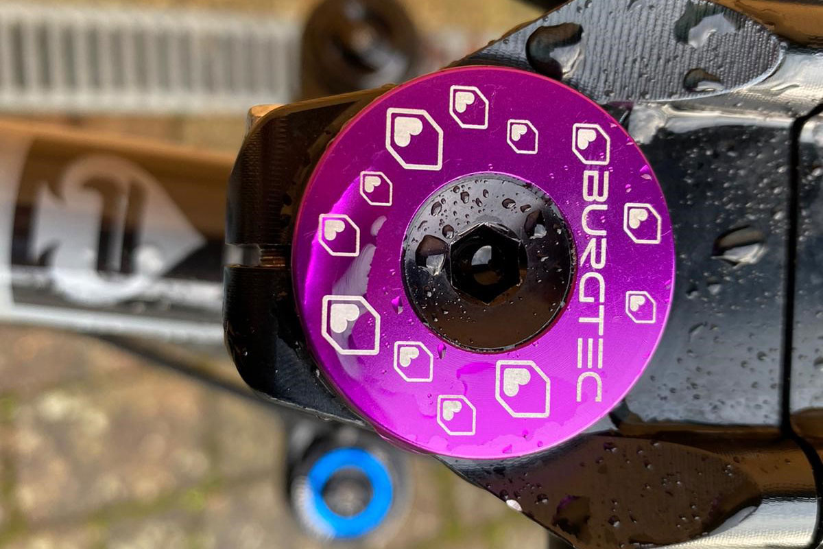Burgtec stem cap in purple for Pace Cycles