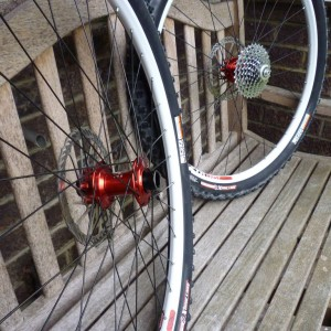 White Stans Crest rims on red Hope Pro2 hubs