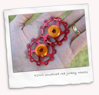 KCNC anodised red jockey wheels